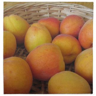 Fresh apricots in a wicker basket napkin