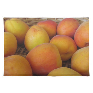 Fresh apricots in a wicker basket placemat