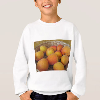 Fresh apricots in a wicker basket sweatshirt