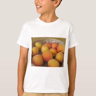 Fresh apricots in a wicker basket T-Shirt