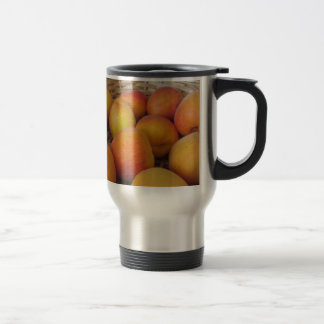 Fresh apricots in a wicker basket travel mug