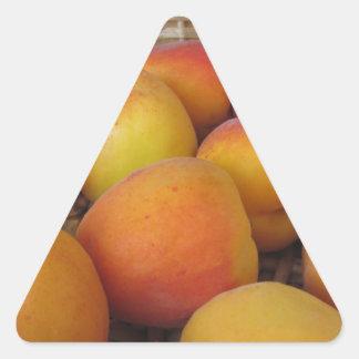 Fresh apricots in a wicker basket triangle sticker