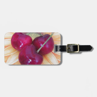 Fresh cherries on sunflower background luggage tag