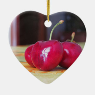 Fresh cherries on the table ceramic heart ornament