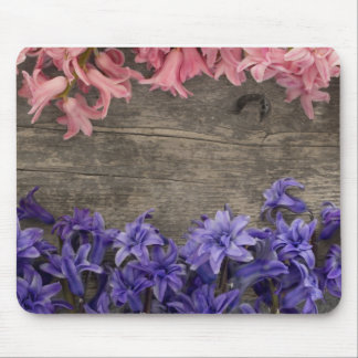 fresh flowers on the old wooden background mouse pad
