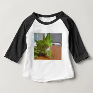 Fresh green hazelnuts on a wooden table baby T-Shirt