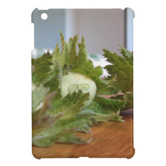 Fresh green hazelnuts on a wooden table iPad mini cases