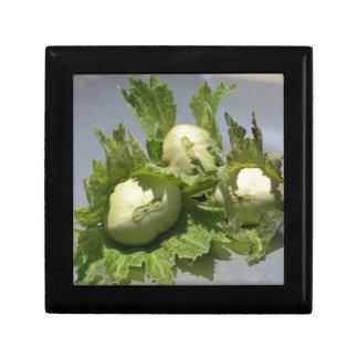 Fresh green hazelnuts on glittering background gift box