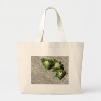 Fresh green hazelnuts on the floor large tote bag