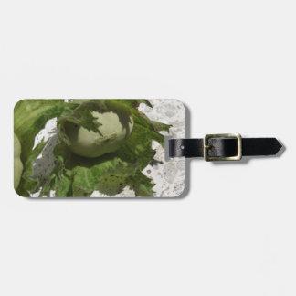 Fresh green hazelnuts on the floor luggage tag