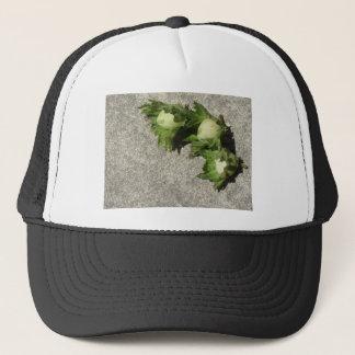 Fresh green hazelnuts on the floor trucker hat