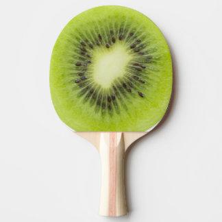 Fresh kiwi fruit. Round slice closeup isolated Ping Pong Paddle