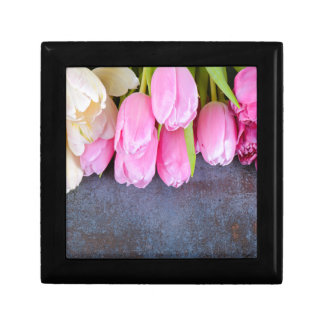 Fresh pink tulips on gray stone background gift box