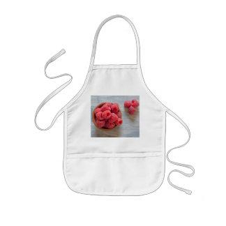 Fresh raspberries in a bowl kids apron