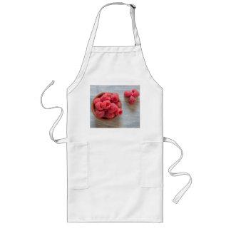 Fresh raspberries in a bowl long apron