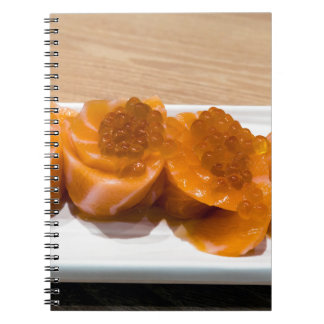 Fresh raw Salmon fish Sushi roll with Salmon Roe Notebook
