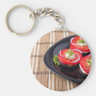 Fresh sliced tomatoes on a black plate close-up basic round button keychain