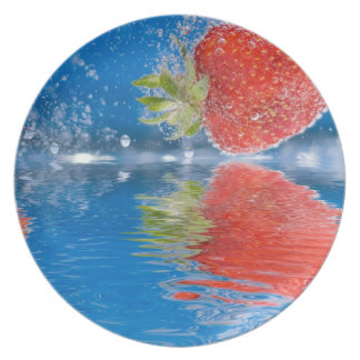 Fresh Strawberries Splashing Into Water Party Plates