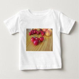 Fresh summer fruits on light wooden table baby T-Shirt