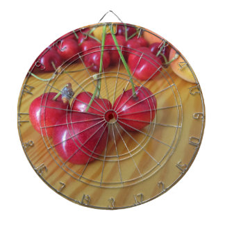 Fresh summer fruits on light wooden table dartboard