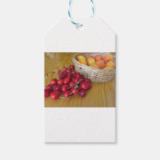 Fresh summer fruits on light wooden table gift tags