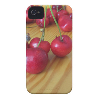 Fresh summer fruits on light wooden table iPhone 4 cover