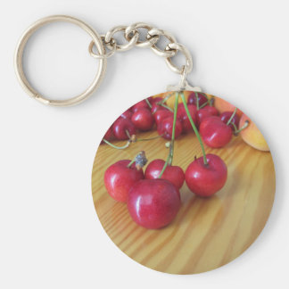 Fresh summer fruits on light wooden table keychain