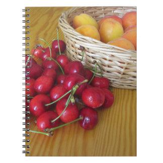 Fresh summer fruits on light wooden table notebook