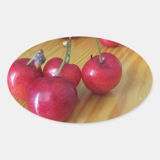 Fresh summer fruits on light wooden table oval sticker