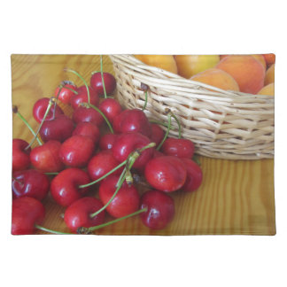 Fresh summer fruits on light wooden table placemat