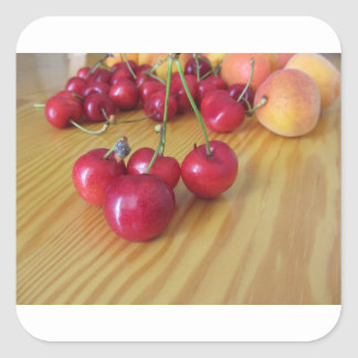 Fresh summer fruits on light wooden table square sticker