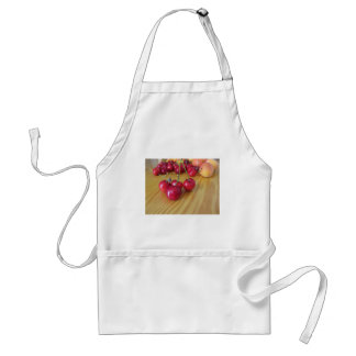Fresh summer fruits on light wooden table standard apron