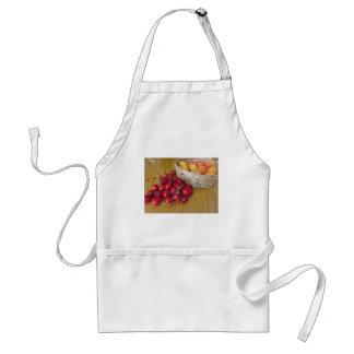 Fresh summer fruits on light wooden table standard apron
