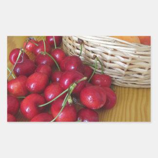 Fresh summer fruits on light wooden table sticker