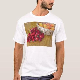Fresh summer fruits on light wooden table T-Shirt