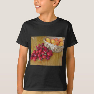 Fresh summer fruits on light wooden table T-Shirt