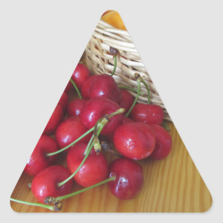 Fresh summer fruits on light wooden table triangle sticker