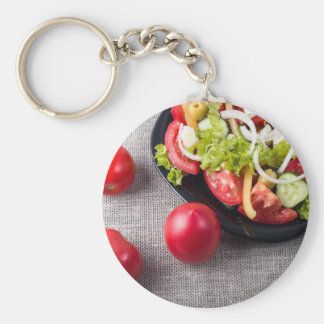 Fresh tomatoes and a part of a plate basic round button keychain