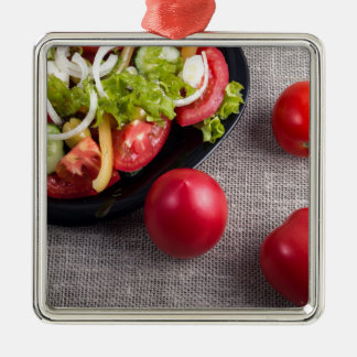 Fresh tomatoes and a part of a plate with salad Silver-Colored square ornament