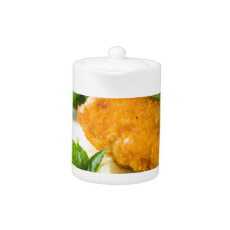 Fried breaded chicken, green beans and mash