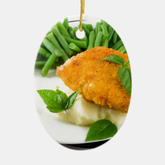 Fried breaded chicken, green beans and mash ceramic oval ornament