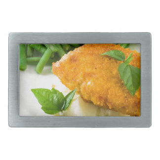 Fried breaded chicken, green beans and mash rectangular belt buckles