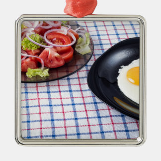 Fried egg with the yolk and tomato salad on fabric Silver-Colored square ornament