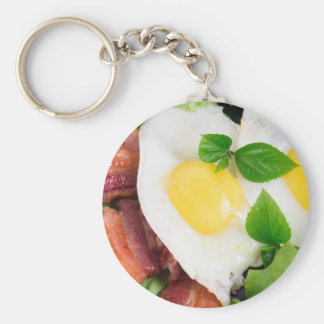 Fried eggs and bacon with herbs and lettuce basic round button keychain