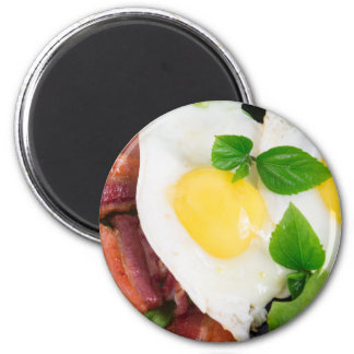 Fried eggs and bacon with herbs and lettuce magnet