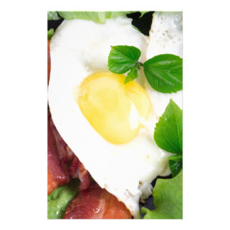 Fried eggs and bacon with herbs and lettuce stationery paper