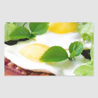 Fried eggs with herbs, lettuce and  bacon