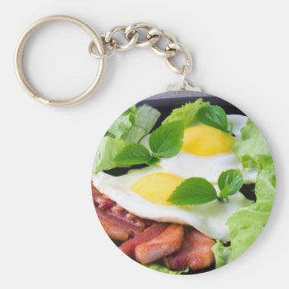 Fried eggs with herbs, lettuce and  bacon basic round button keychain