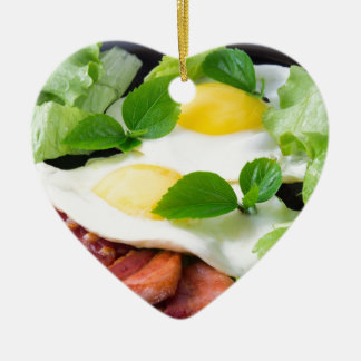 Fried eggs with herbs, lettuce and  bacon ceramic heart ornament