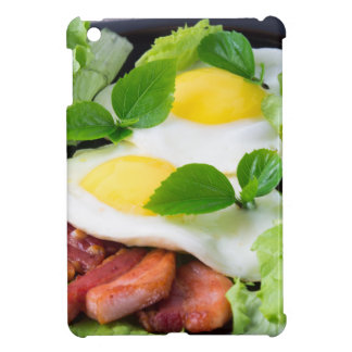 Fried eggs with herbs, lettuce and  bacon cover for the iPad mini